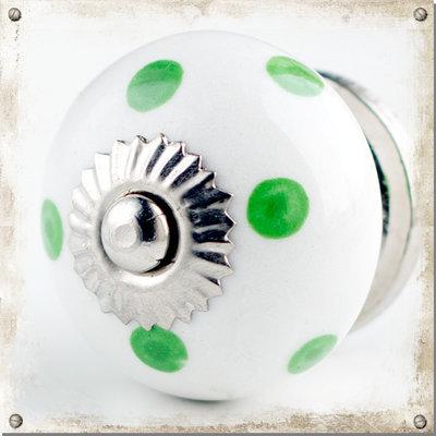 Vit rund knopp med gröna prickar