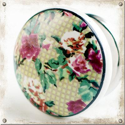 Färgglad blommig knopp i porslin