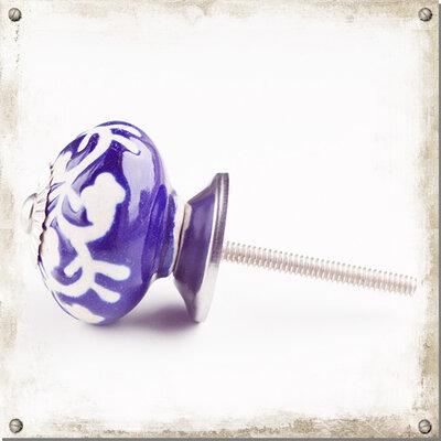 Blå knopp i porslin med vitt mönster