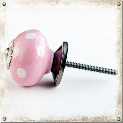 Rosa knopp i porslin med vita prickar