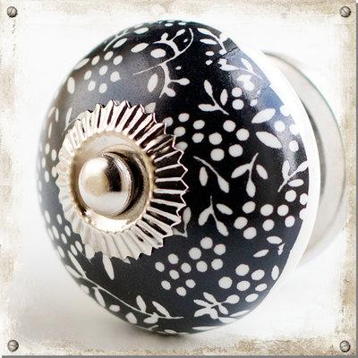 Rund knopp i porslin med svart/vitt mönster