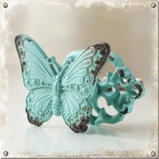 Turkos knopp med fjäril