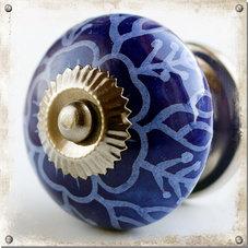 Mörkt blå knopp i porslin
