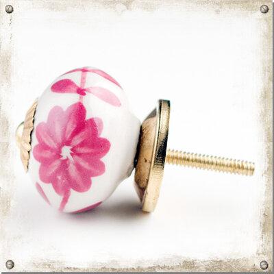 Vit knopp i porslin med stora rosa blommor