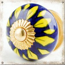 Blå knopp med gula kronblad