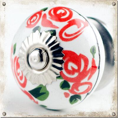 Vit knopp i porslin med röda rosor
