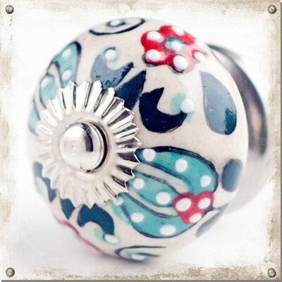 Rund knopp i porslin med färgglatt mönster