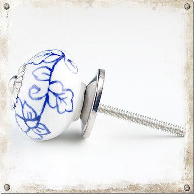 Vit rund knopp med blå blomgirlang
