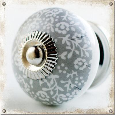 Rund knopp i porslin med grå/vitt mönster